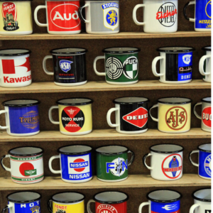 A Shelves of Mugs Not From Mary Hinge - the Funny and Rude Mug Shop